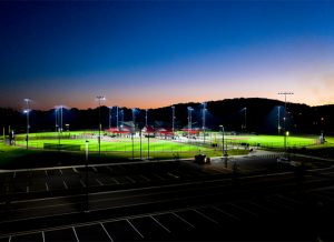 Cedar Stone Park fields and parking area at sunset