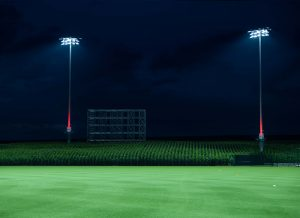 Musco 5 Easy Pieces poles lit with red Show-Light+ at Field of Dreams