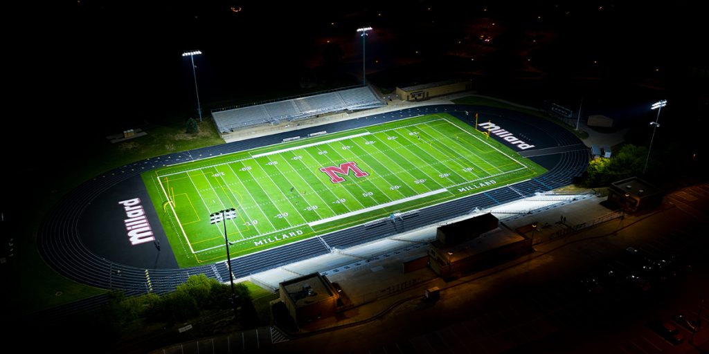 Buell Stadium football field lit at night with Musco TLC for LED system